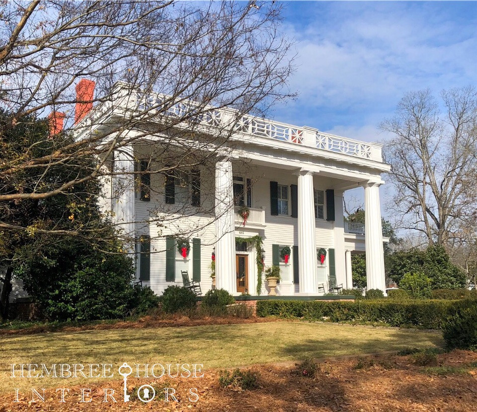 White Greek Revival home in Madison Georgia decorated columns for Christmas