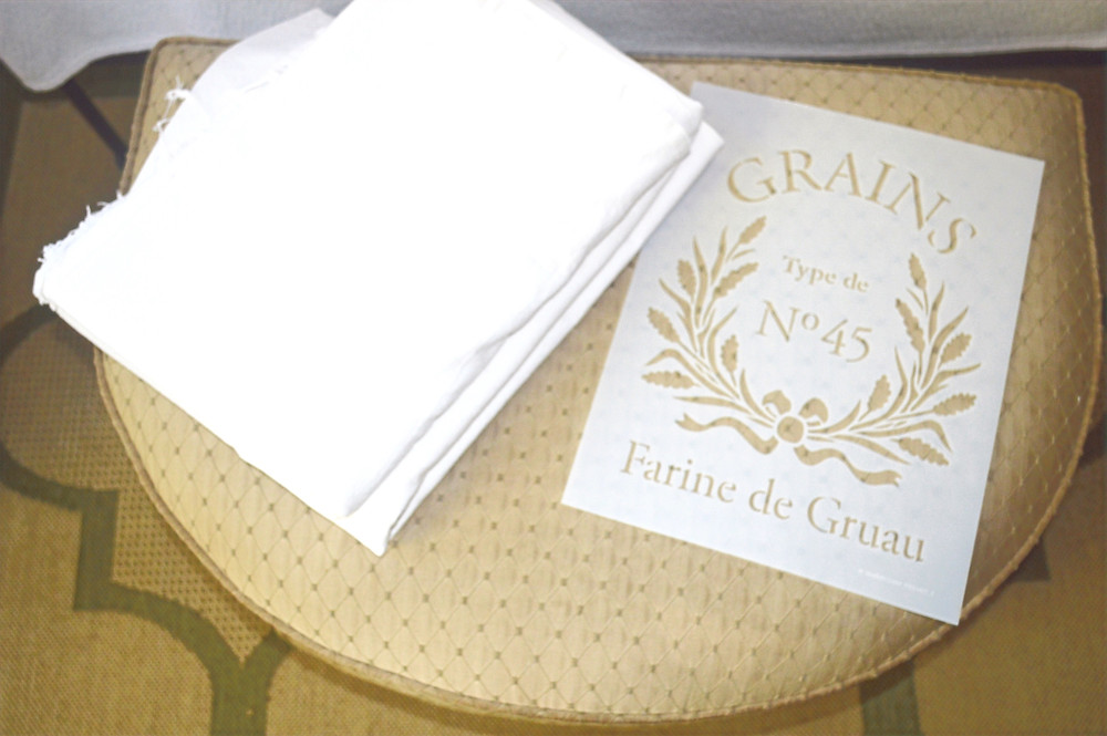 dropcloth and French stencil used for making slipcovers