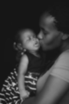 grayscale-photo-of-woman-kissing-child-3