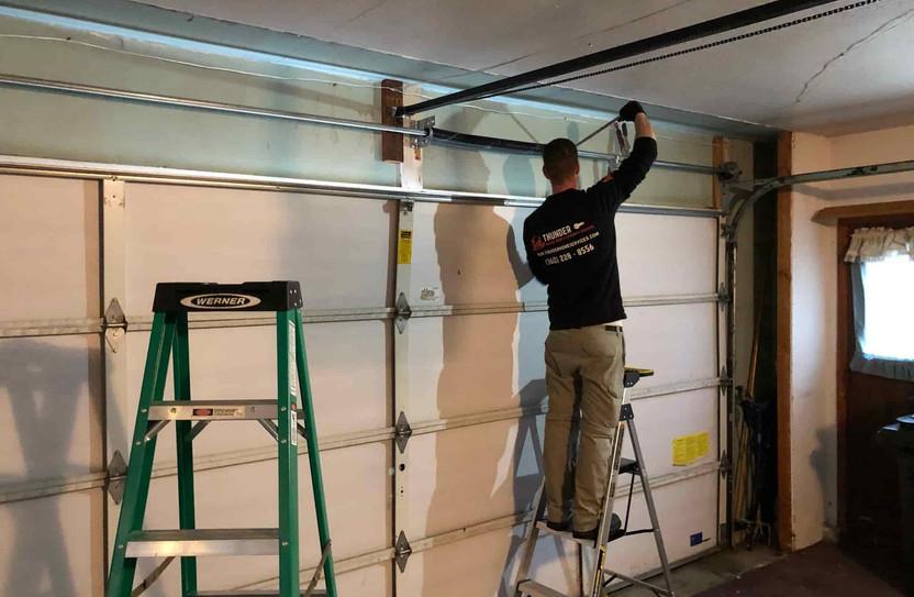 garage door torsion spring tightening