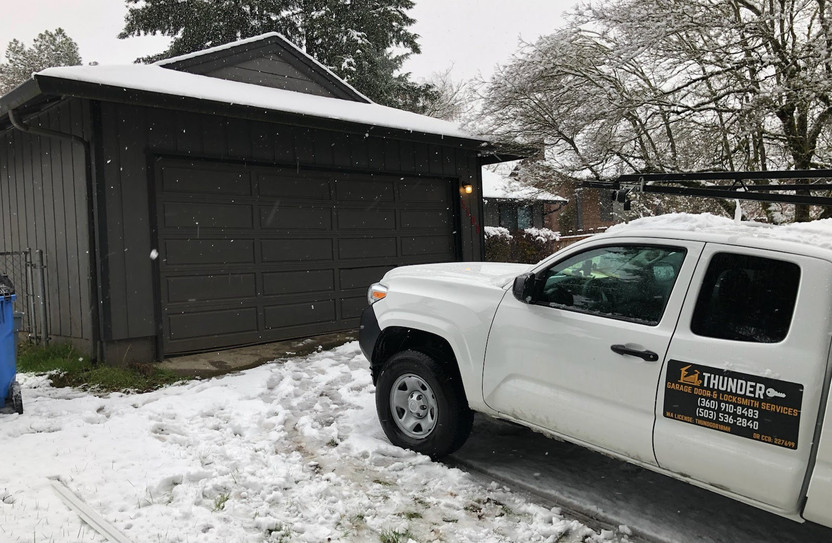 new door installation in the snow.jpg