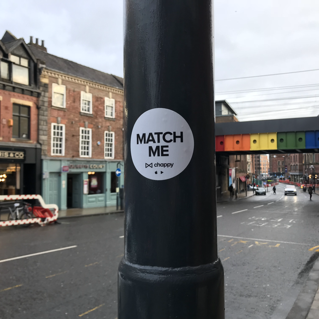 Lamppost stickering in Leeds LGBT areas to promote the app