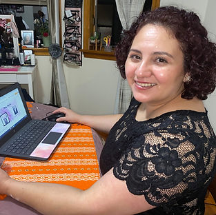 A TGH learner works on her Chromebook