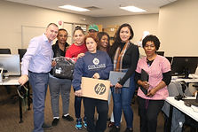 A group of Tech Goes Home learners with their new Chromebooks