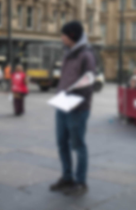 Defocused blurred  man stands in the str