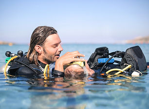 Scuba diver rescuing a girl who doesn't