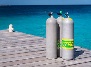 Scuba cylinders on a dock, Bonaire, Neth