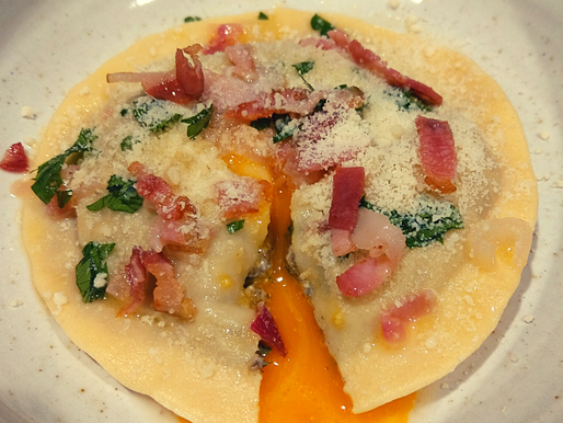 Roasted mushroom Egg Yolk Raviolo with crispy bacon