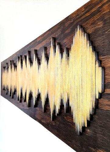 Gold Soundwave on Dark Backing Board