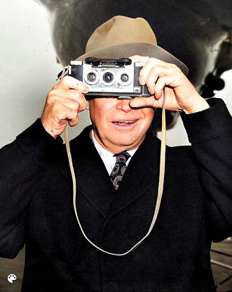 1953_12_25 Ike photographs his photographs in DC before he departs for Augusta GA_hi_resai