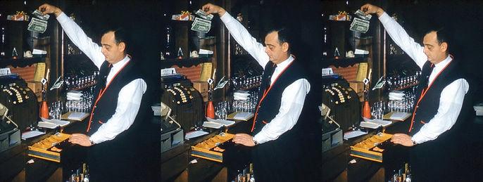 Bartender_dropping_into_the_cash_registe