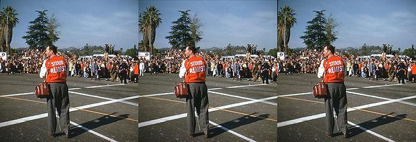 John Meredith in street wearing Stereo R