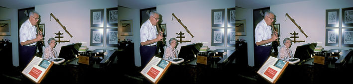 1990 Claire Wing playing piano with Paul