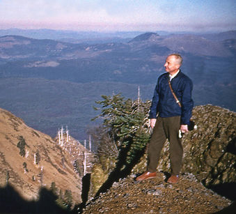 1956 William Gruber standing on Saddle M