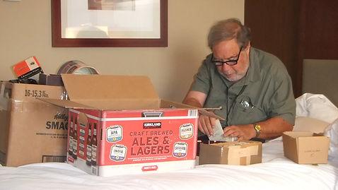 Sheldon Aronowitz sorting through boxes