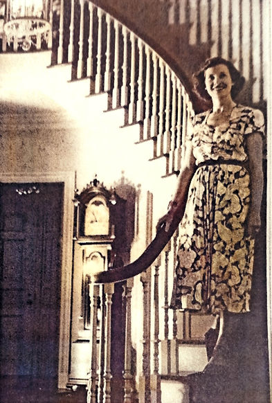1951 Norma Gruber in the foyer on stairs