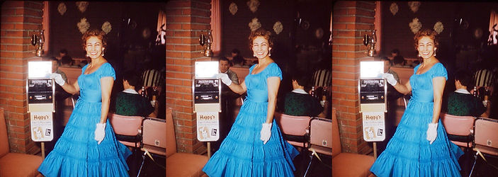 Woman_in_tiered_blue_dress_standing_next