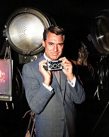 1959 Cary Grant holding a Stereo Realist