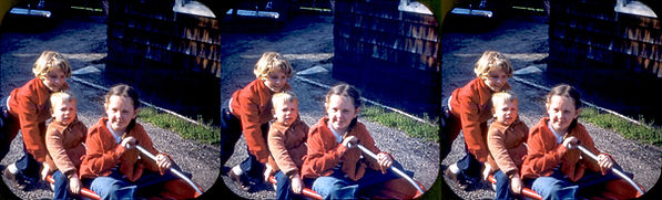 Gruber kids in a little red wagon by Wil