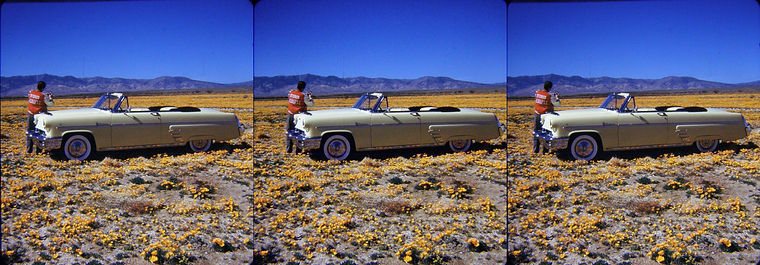 John Meredith with convertible car in a