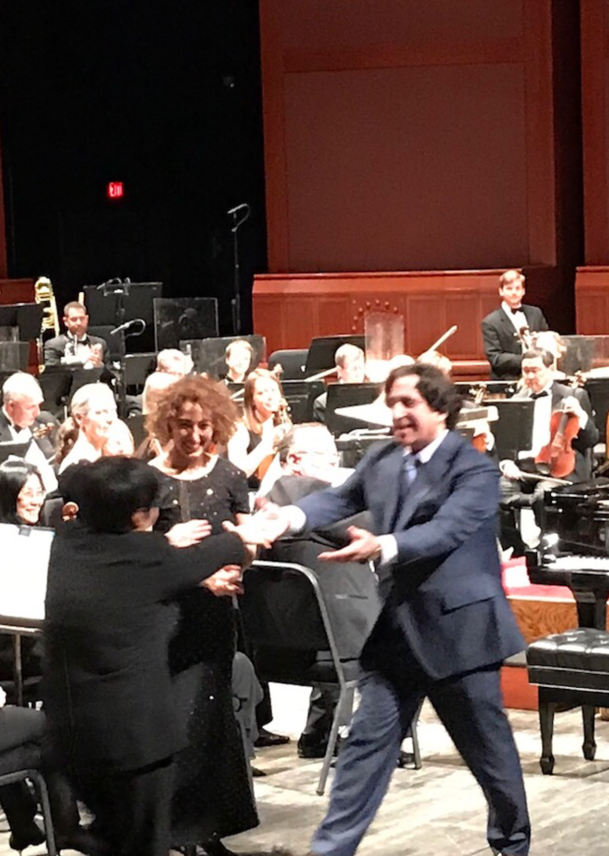 Richard Danielpour congratulating conductor XIan Zhang, with pianist Sara Daneshpour on the premiere