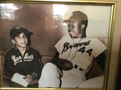 Richard as a young ballboy for the Yankees with Hank Aaron