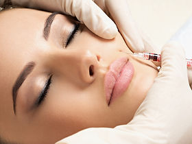 Young woman has a botox injections. Beauty treatment with hyaluronic collagen  injection.