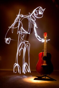 Guitar with Light Man