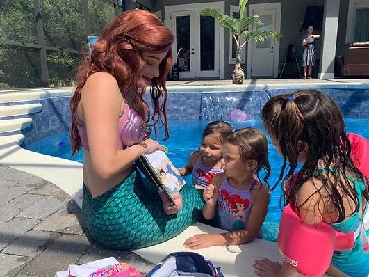 Atlas loved meeting our mermaid for her