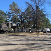 Row of parked RVs at Hot Springs RV Park