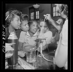 Inquiring Minds - Girls and STEM Here, children take part in a science class, Washington, March 1942