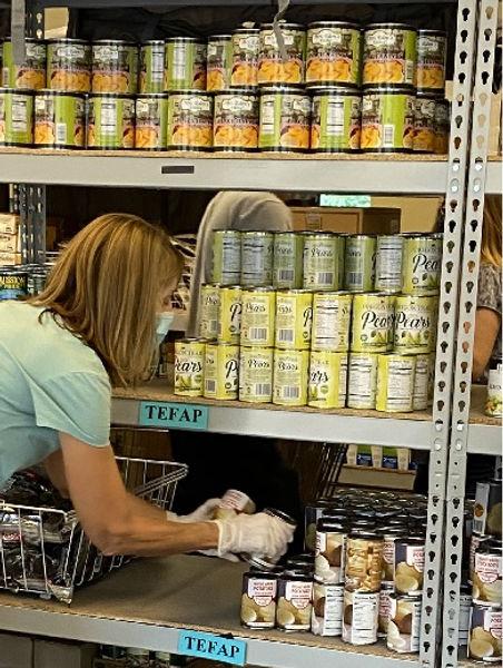 Stocking pantry shelves_3.jpg