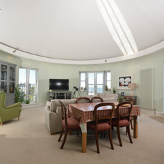 Oval-shaped reception room with sea views