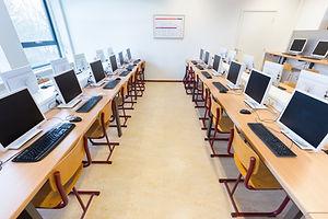 Desktop computers in computer lab on high school