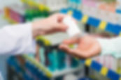 Pharmacists' hands deivering medicine