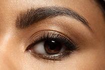 Close-up of make-up eye with long eyelas