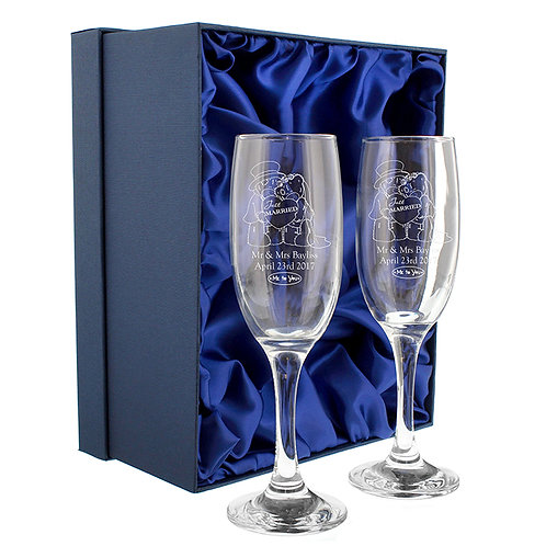 An elegant and adorable pair of Champagne Flutes - a lovely idea for a Wedding present for the happy couple!
