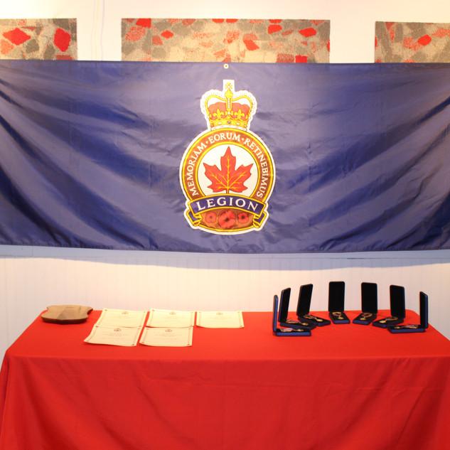 Legion medals, certificate and plaque.