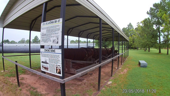 """A piece of metal from the """"Oklahoma"""" sunk at Pearl Harbor, at rest in Oklahoma"""