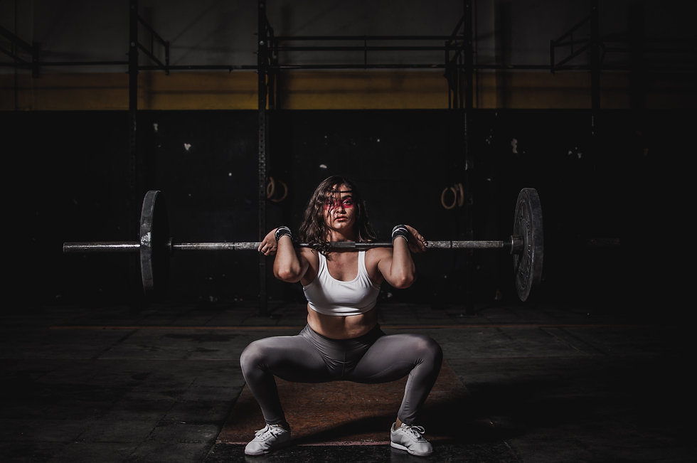 woman-lifting-barbell-1552249.jpg