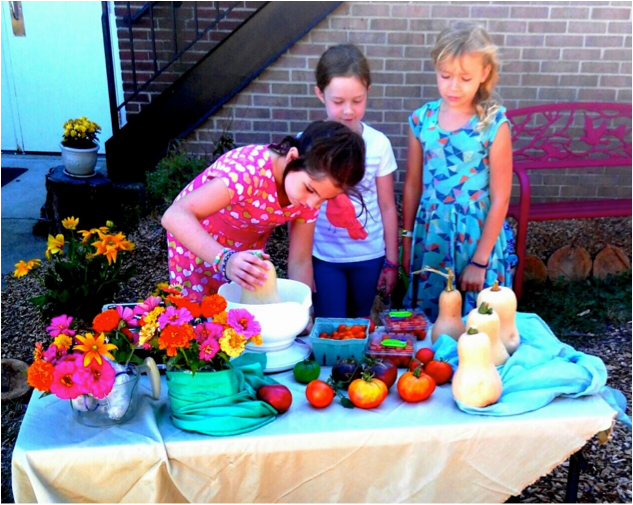 Third grade students sell vegetables and flowers at school dismissal.