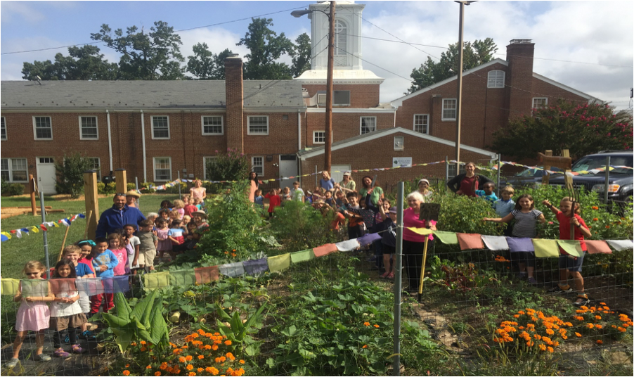 The school community gathers in the garden.