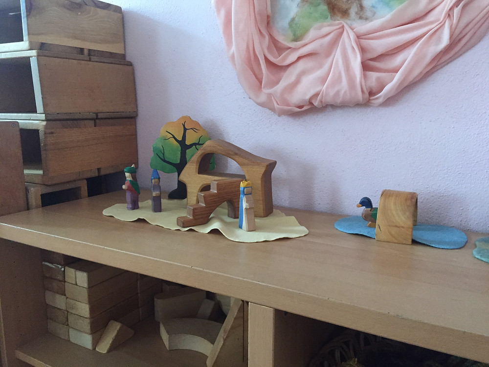 Play scene with wooden figures
