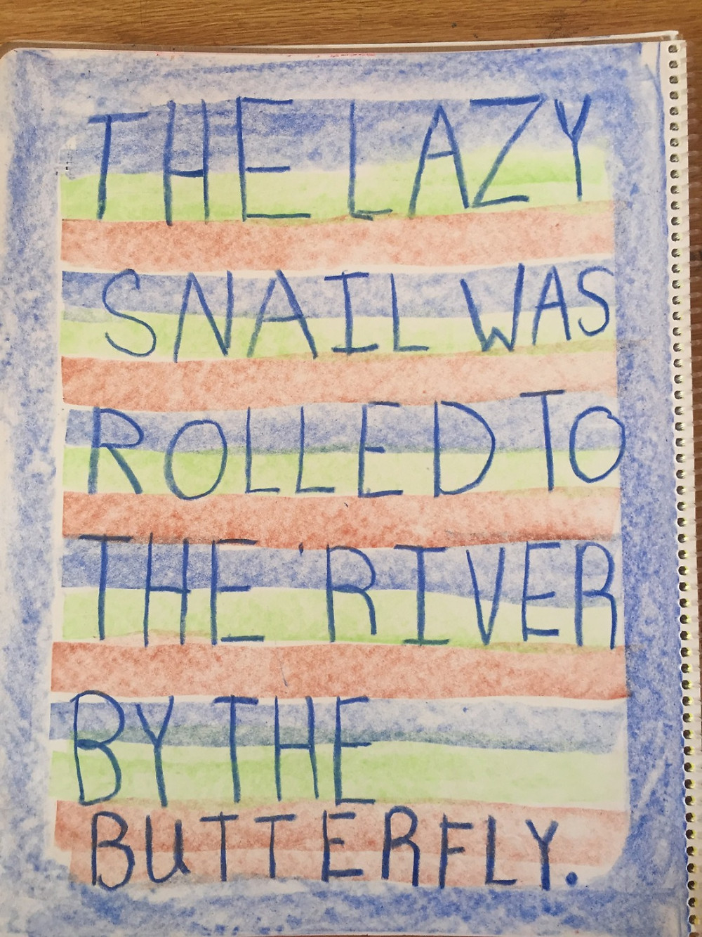 """The lazy snail was rolled to the river by the butterfly"" written by a PCWS first grader."