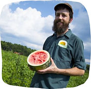 Zeb Baccelli of Clarion River Organics holds watermelon at Amish farm