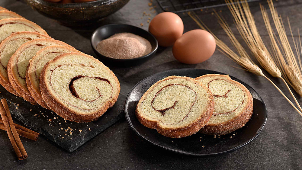 A display Jennie Swirl Bread with ingredients including eggs, cinnamon, and grain