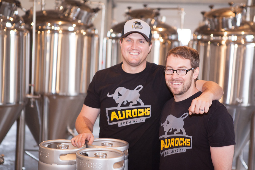 Ryan and Doug, owners of Aurouchs Brewing Company, stand in their brewery