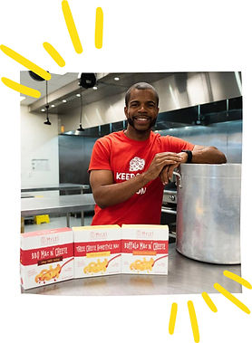 A graphic with a photo of Myles Powell, owner of 8 Myles, holding mac and cheese products