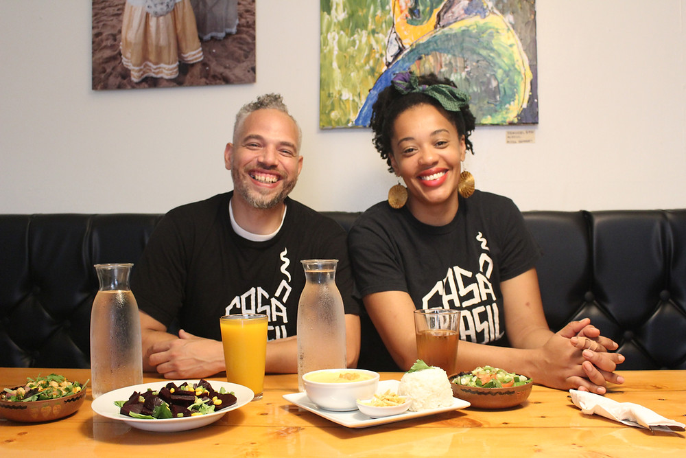 Keyla and Tim, owners of Casa Brasil in Pittsburgh, at a table in their restaurant