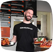 Restaurant owner Pete Tolman of Iron Born Pizza holds detroit-style pizzas in his Pittsburgh restaurant